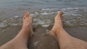 Men`s legs in the sea stock video footage