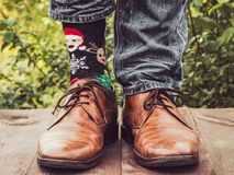 Men's legs in stylish shoes, bright, variegated socks stock image