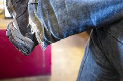 Free Men`s Legs With Worn And Tattered Jeans At The Bottom Stock Photo - 144416430