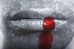 Men's lip with a silver makeup and blood Royalty Free Stock Images