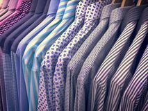 Men`s Long Sleeve Patterned Shirts on Rack. Closeup Men`s Long Sleeve Patterned Shirts on Rack Stock Photos