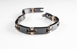 Men's luxury black metal and copper chain bracelet with unique design. Black metal and copper luxury silver masculine chain bracelet with links and clasp royalty free stock photo