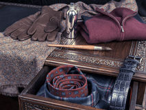 Men's luxury casual outfit on antique table. Gentleman's luxury accessories on a wooden table stock photography