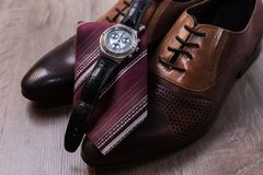 Shoes with tie and watch. Men`s mans fashion accessories. Shoes with tie and watch Royalty Free Stock Photo