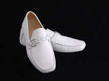 Men's moccasins. A new white men's moccasins on black Royalty Free Stock Photos