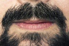 Men's mustaches and lips closeup Stock Photos