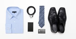 Men`s outfits with blue shirt. Clothes shop Royalty Free Stock Images