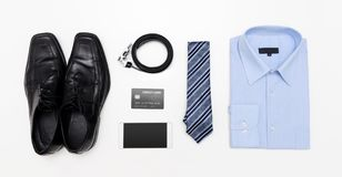 Men`s outfits with blue shirt. Clothes shop. Top view concept Stock Photo