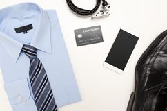 Men`s outfits with blue shirt. Clothes shop. Top view concept Stock Photography