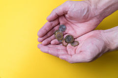 Men`s palms with coins. Lack of money. Low wages Royalty Free Stock Photography