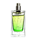 Men's perfume in beautiful bottle in water drops isolated on whi Royalty Free Stock Photography