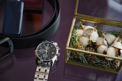 Men& x27;s perfume and wrist watches in a box close-up. Men& x27;s accessories stock photography