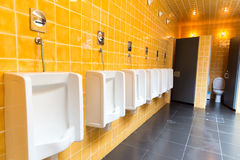 Men's public toilet Stock Image