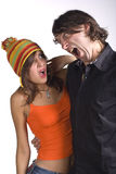 Men's rage. Young man and girl shout against each other. emotional Royalty Free Stock Photos