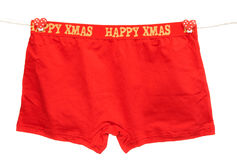 Men's red panties. Men's red shorts weigh on a rope stock image