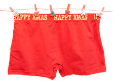 Men's red panties. Men's red shorts weigh on a rope royalty free stock photography