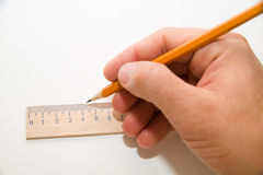 Men's right hand holding a pencil on over white Royalty Free Stock Image