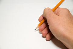 Men's right hand holding a pencil on over white Stock Image