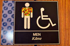 Men's Room sign in Honolulu International Airport Royalty Free Stock Photography
