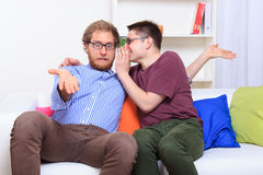Men's rumors on the couch Stock Photography