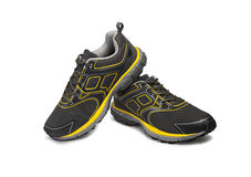 Men's running shoes. Closeup of men's sports running shoes on a white background. With clipping path Stock Photo