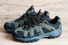 Men's running shoes on wooden background Stock Photos
