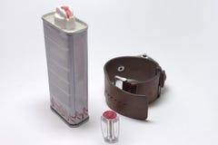 Men`s set of wrist watch, plastic flint holder and lighter fluid Stock Images