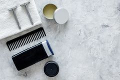 Men`s shaving. Tools and cosmetics on grey stone background top view copyspace Royalty Free Stock Images
