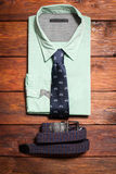 Men's shirt, a tie with a  and a belt Royalty Free Stock Photo