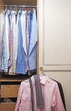 Men's shirts in bedroom Royalty Free Stock Photos