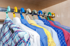 Men's shirts in the closet. Stock Photos