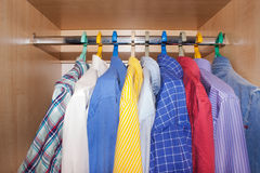 Men's shirts in the closet. Royalty Free Stock Photo