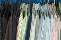 Men's Shirts In A Closet Stock Image