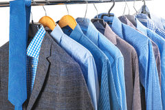 Men's shirts on hangers Stock Photo