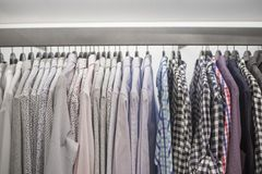 Men`s shirts on hangers Royalty Free Stock Photo
