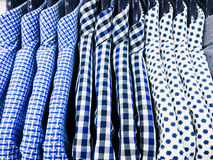 Men`s shirts hanging Royalty Free Stock Photos