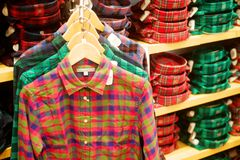 Men's shirts hanging in trendy boutique Royalty Free Stock Images