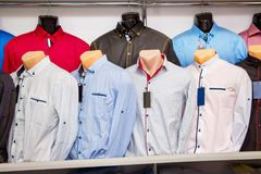 Men`s shirts on  showcase in a trendy boutique. Stylish clothes. For sale Stock Image
