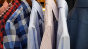 Men`s shirts in the store. stock footage
