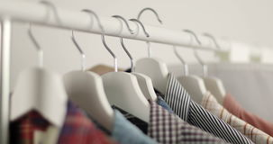 Men`s shirts store. Men`s hands choose a shirt in their wardrobe. Male choosing lothes to wear in closet. 4K stock video