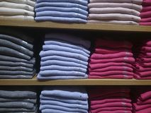 Men`s shirts on store shelves stock photo