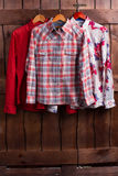 Men's shirts on a wooden fence. Men's shirts on a wooden fence in a fitting room Stock Images