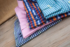 Men's shirts on wooden table Royalty Free Stock Photography