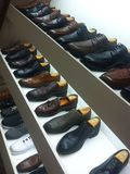 Mens shoe display Royalty Free Stock Images