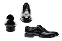 Men's shoes. Black varnished leather men's shoes on white background Royalty Free Stock Images