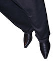 Men's shoes. Man's black dress shoes, and pant legs shown from the knee down, isolated on white background Royalty Free Stock Images