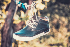Men's shoes in the air Royalty Free Stock Images