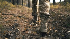 Men`s shoes in autumn a man tied a lacing on boots in the woods stock video