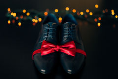 Men`s shoes and bow tie. Wedding accessories. And groom clothes Royalty Free Stock Photography