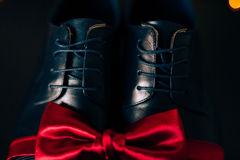 Men`s shoes and bow tie. Wedding accessories. And groom clothes Stock Image